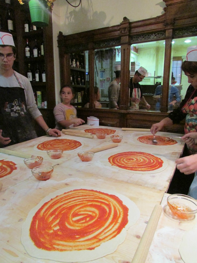 Baby Boomer Travel | Italy | Swirling Tomato Sauce - Pizza Making - Rome