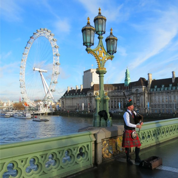 Baby Boomer Travel | London, England | Bagpiper - London Eye