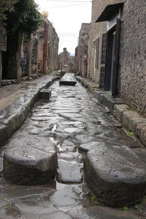 Boomer Travel | Italy | Pompeii street in rain
