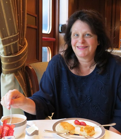 Having tea aboard the Queen Elizabeth - travel products and resources for Baby Boomers