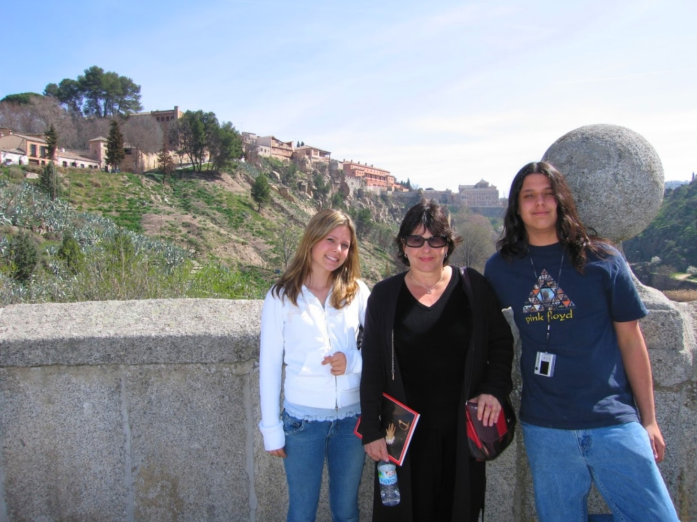 Standing on the St Martins Bridge in Toledo Spain with my kids #travelspain #toledospain #stmartinsbridge
