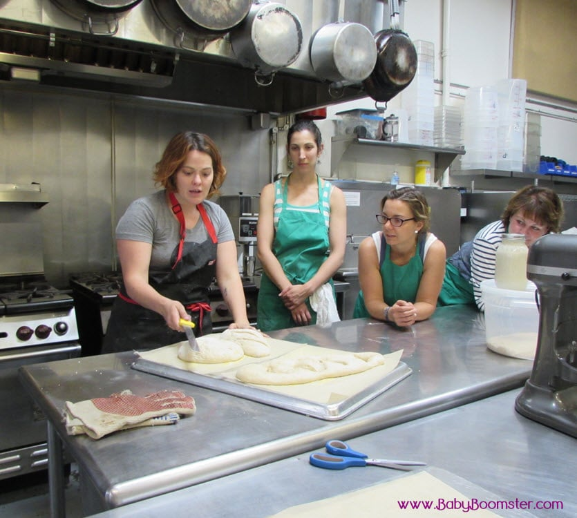 Baby Boomer women | Making bread | Slashing the dough