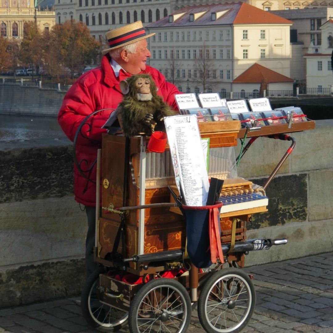 An organ grinder and his monkey on the Charles Bridge Prague, Czech Republic #prague #czechrepublic #Czechia