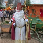 St. Nicholas pays a visit to the Thurn und Taxis Christmas Market in Regensburg, Germany to add to the fun. #Germany #Regensburg #ChristmasMarket #holidays