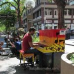 Man playing piano in Denver