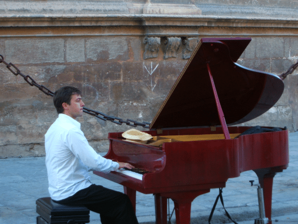 Baby Boomer Travel | Seville, Spain | Pianist outside Seville Cathdral
