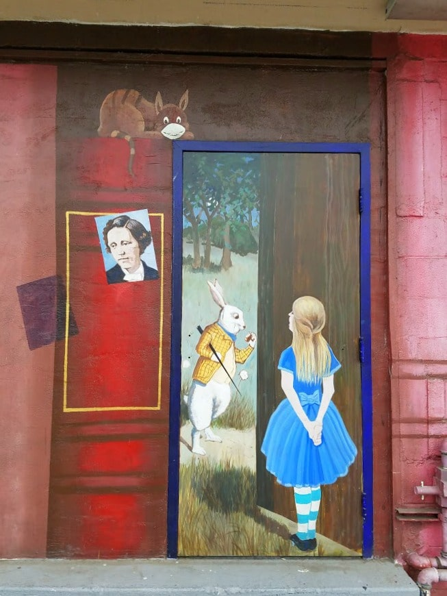 Baby Boomer Travel | Street Art | Alice at the Iliad Bookstore in NOHO