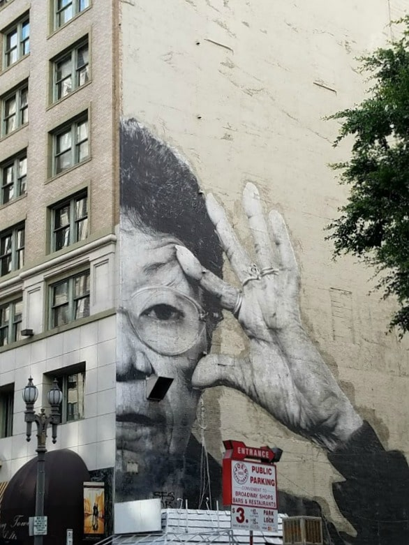 Baby Boomer Travel | Street Art | Woman with Glasses Mural
