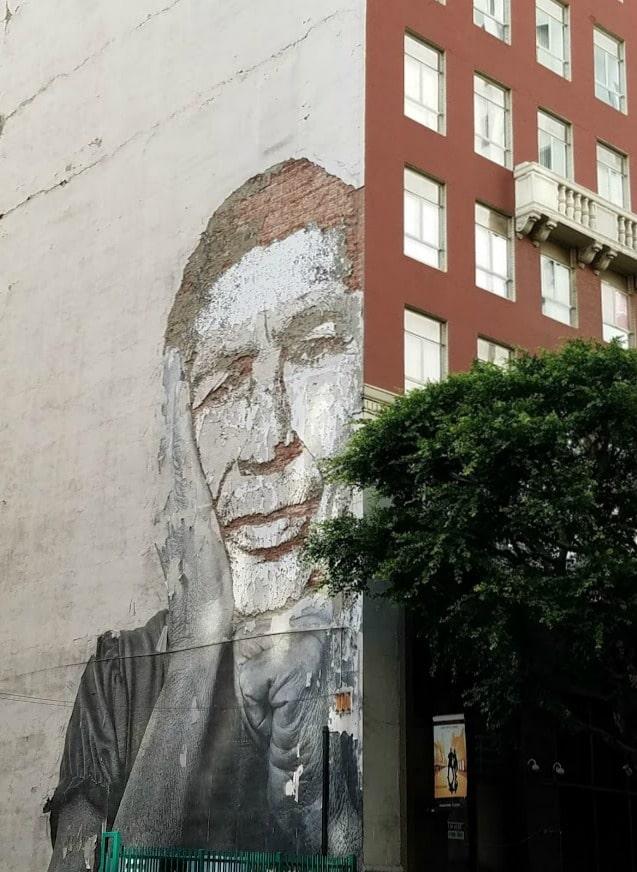 Baby Boomer Travel | Street Art | Worn Mural of Man on Wall