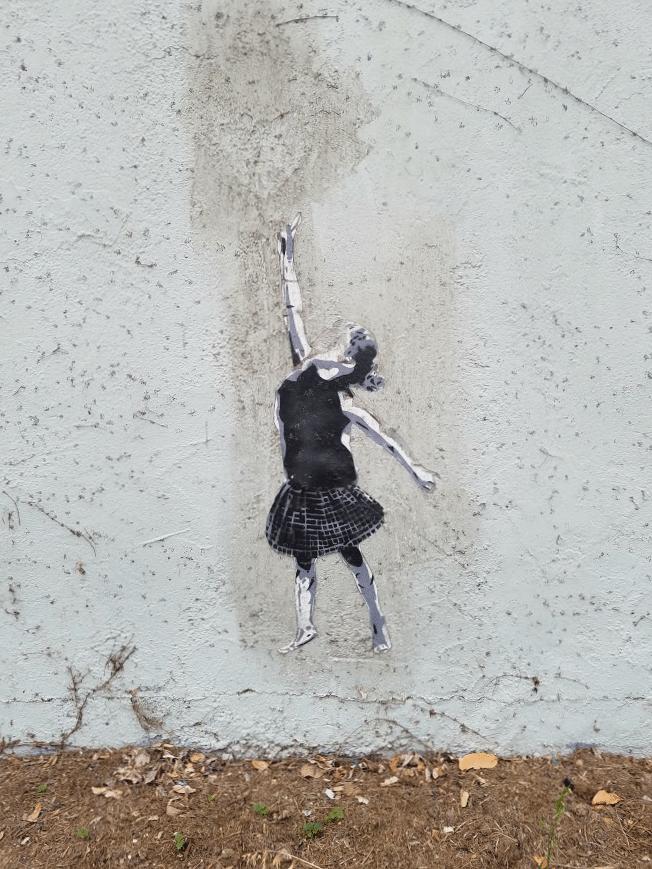 Baby Boomer Travel | Street Art | Girl reaching up - NOHO bike path