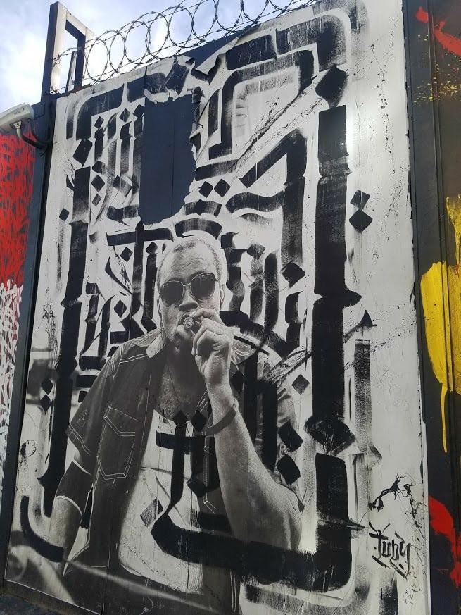 Baby Boomer Travel | Street Art | LA Arts District | Man with cigar