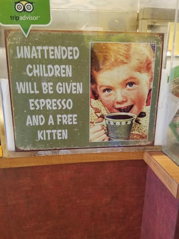 Unattended Children will be given expresso and a free kitten - #sign #coffeehouse at Trailhead Cafe, Lake Louise #Canada