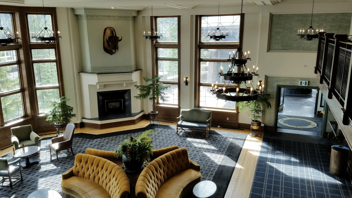 A parlor with Buffalo head over the fireplace at the Banff Springs Hotel