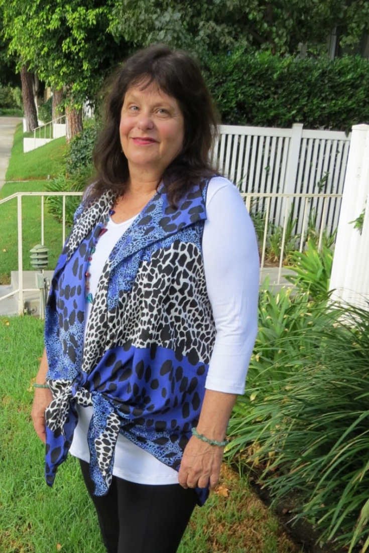 Covered Perfectly blue and black animal print chiffon cascading vest tied at the bottom is an alternative way to wear it. #womenover50 #styleover50 #fashionover50 #midlife #shopping