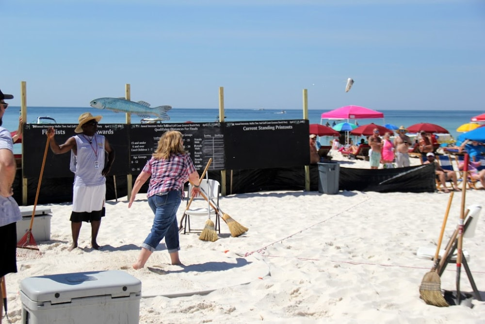 Chucking a mullet fish from Alabama to Florida in the Flora Bama annual mullet toss #Alabama #Florabama #fishtoss