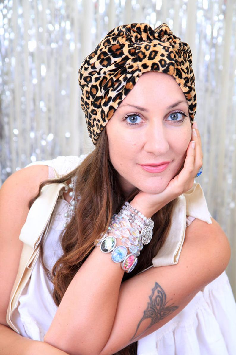 This Leopard print turban on etsy will look fabulous with a black dress or even with a pair of jeans. #Fashionover50 #ad #styleover50 #accessories