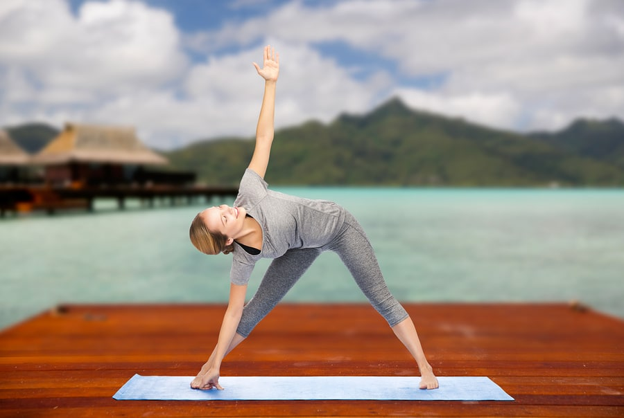 Triangle pose - It's great for a full body stretch - #womenover50 #fitnessover50 #yogaposes #easyyoga