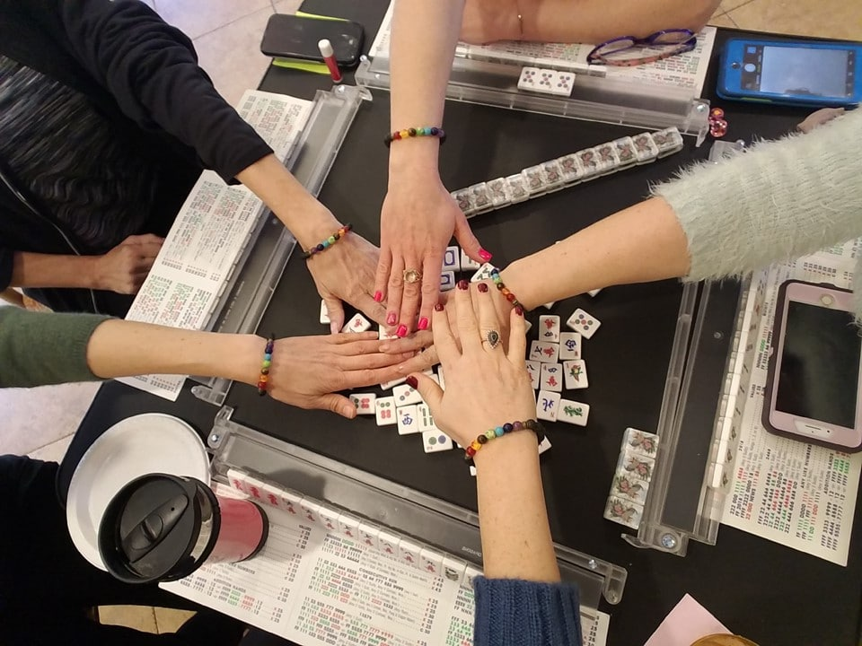 Women playing Mah Jongg