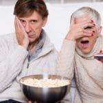 Mature couple watching TV