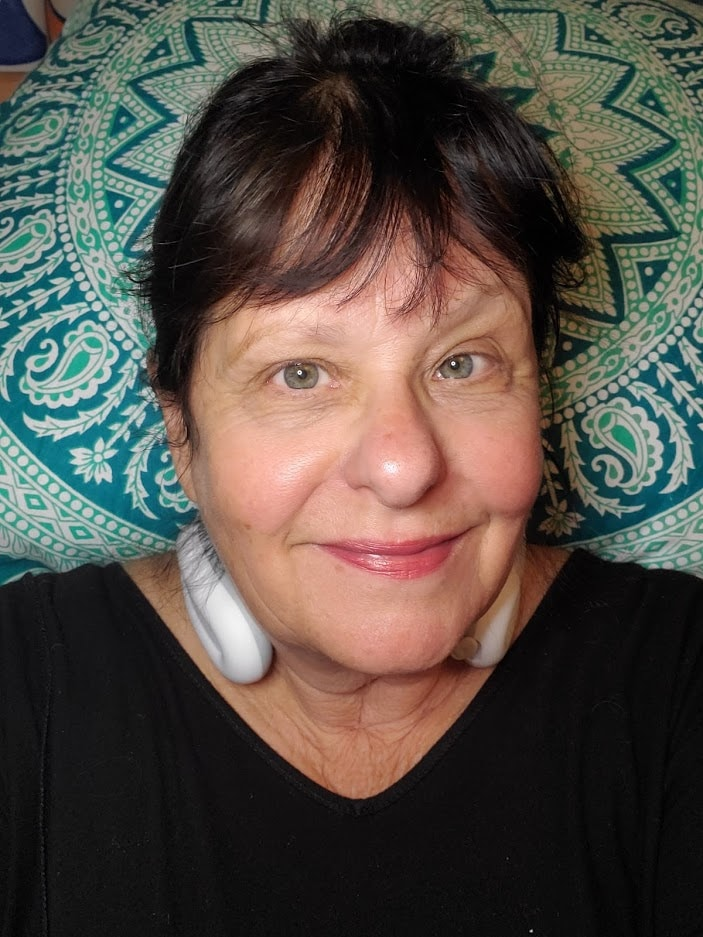 Wearing the RelaxUltima neck massager. Uses TENS technology and is cordless. You can take it anywhere. #neckpain #neckmassager #RelaxUltima #ad