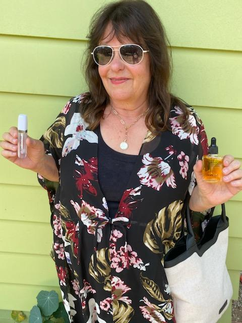 Looking stylish wearing and holding what is in the Curateur Summer Box 2021