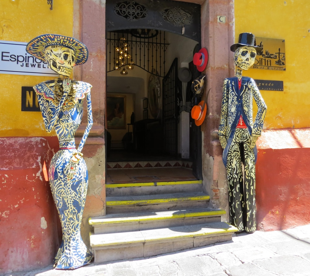 Day of the Dead skeletons at entrance to courtyard in San Miguel de Allende